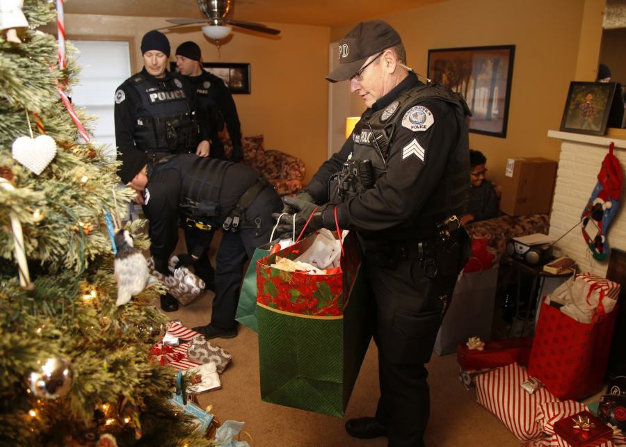 vancouver police place gifts saturday around the christmas tree of nicole cole and her family - Christmas Gifts For Police Officers