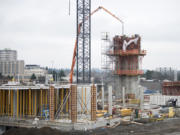 Construction continues on Block 6 at The Waterfront Vancouver on Friday morning. Gramor Development, the Tualatin, Ore.-based firm overseeing the redevelopment, said two buildings on the block could be completed by September.
