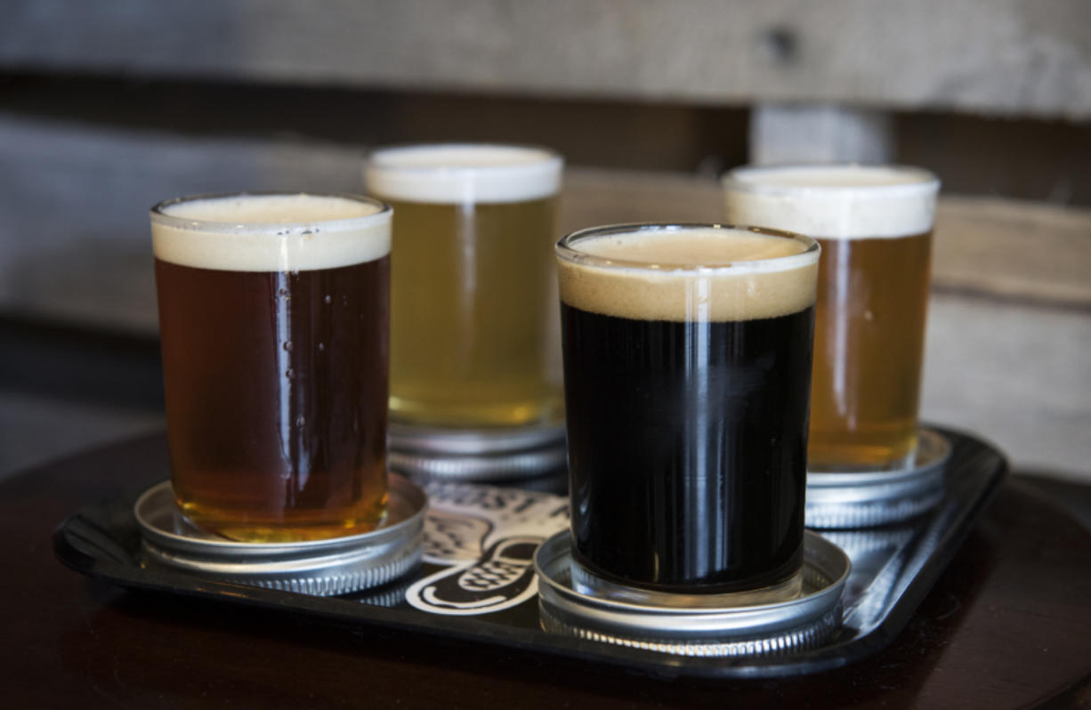 Ghost Runners Brewery's 5K IPA, Running UP Pils pilsner, Phantom Rojo imperial red and Amanda Hugginkiss Porter raspberry imperial porter are served in a flight in Vancouver are seen in June.
