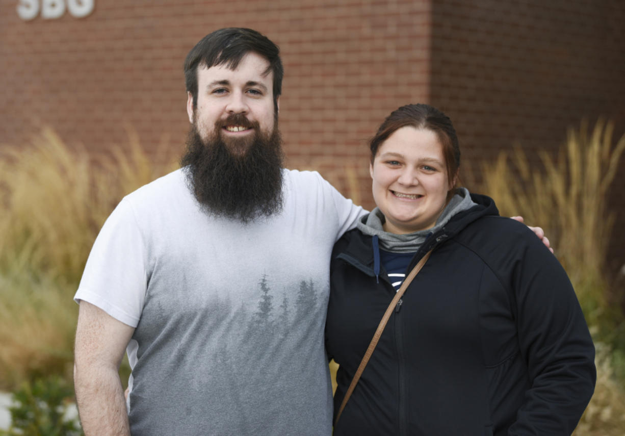 Cody Messick, left, and his wife, Kasey Cannon, outside the STEM building at Clark College in November. Ariane Kunze/The Columbian