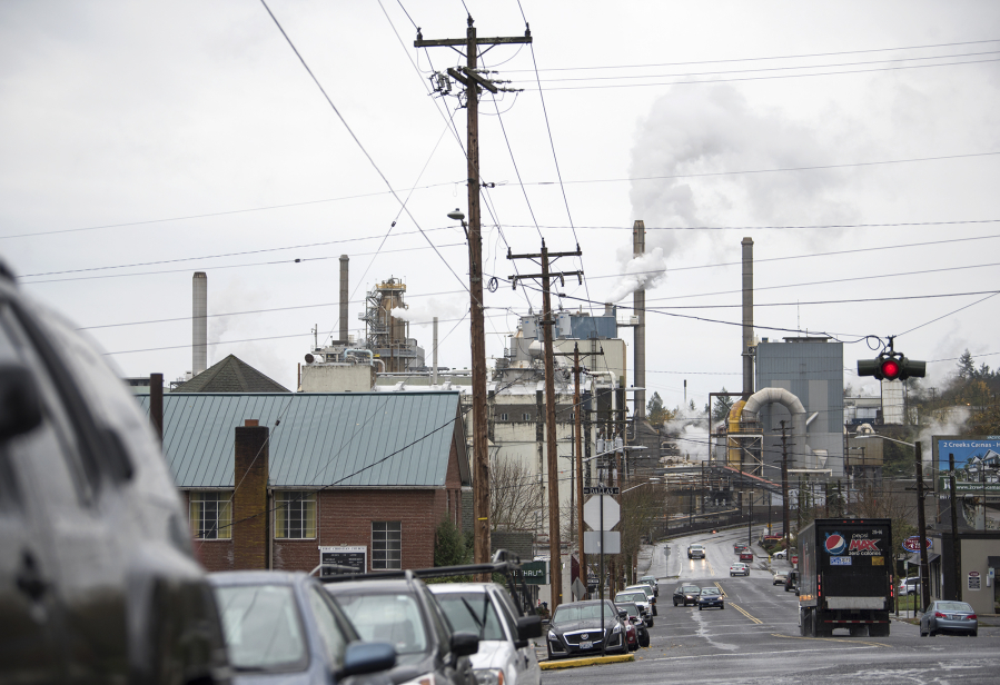 The Georgia Pacific paper mill is visible from Northeast 6th Avenue in Camas. The company announced Nov. 14 plans to shut down several operations at the mill. alisha jucevic/The Columbian files
