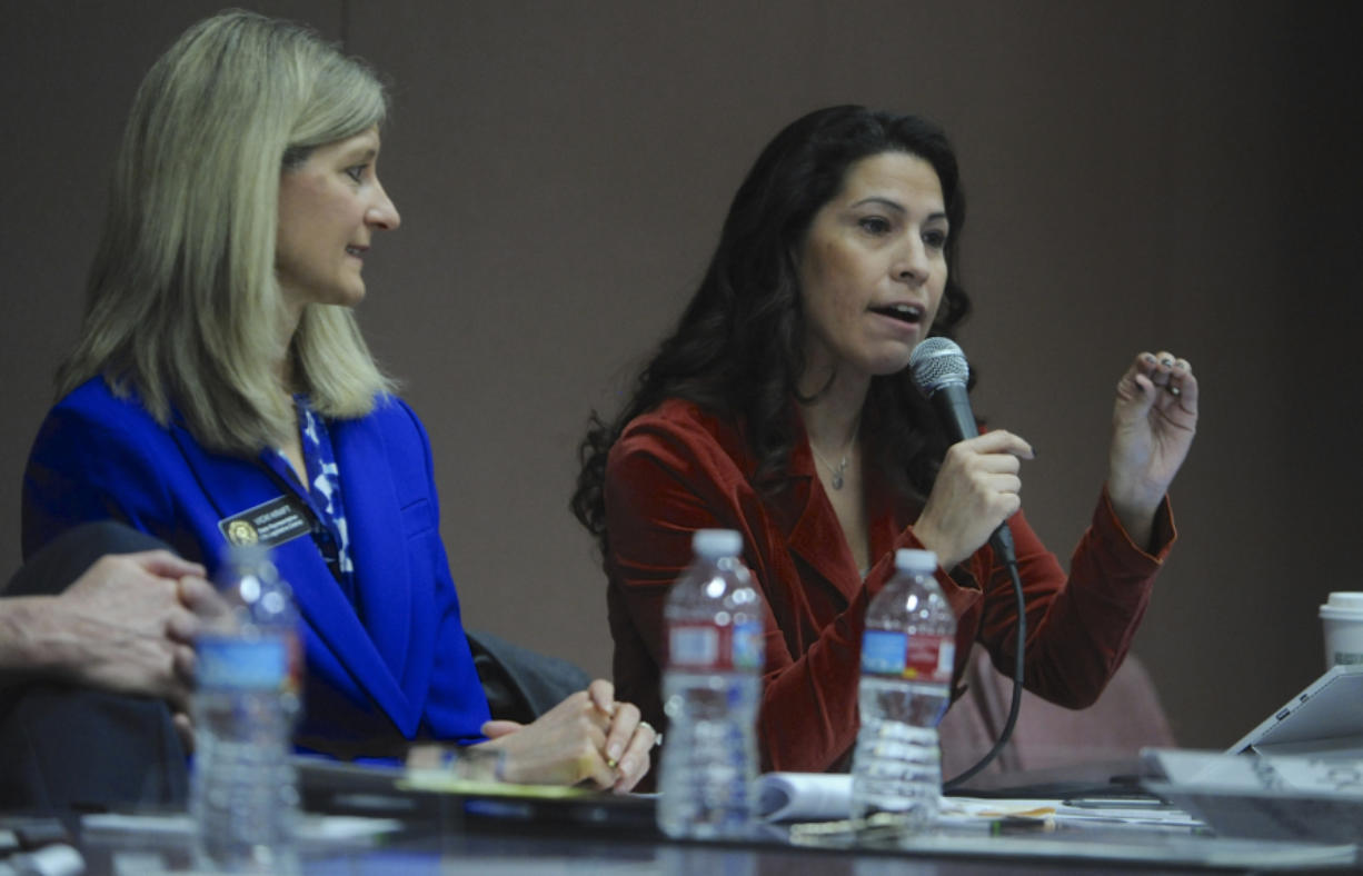 Rep Vicki Kraft listens as Rep Monica Stonier, right, answers questions as teachers, parents and public school supporters rally at a 2017 town hall with legislators at Roosevelt Elementary in Vancouver. Stonier has been elected to be serve as House deputy majority whip.