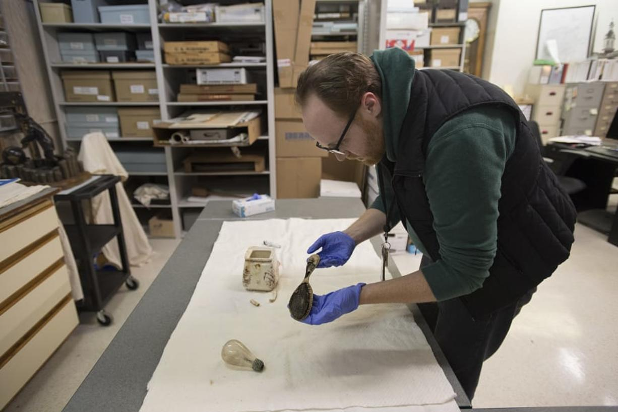 James Kice, administrative assistant for Clark County Historical Museum, looks over a comb that was recovered when they built one of The Columbian's parking lots.