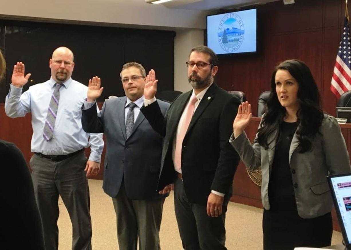 Battle Ground councilors, from left, Brian Munson, Mike Dalesandro, Adrian Cortes and Cherish DesRochers are sworn in for their new terms at Tuesday night's meeting. Dalesandro was selected by his fellow councilors to be the city's mayor for the next two years.