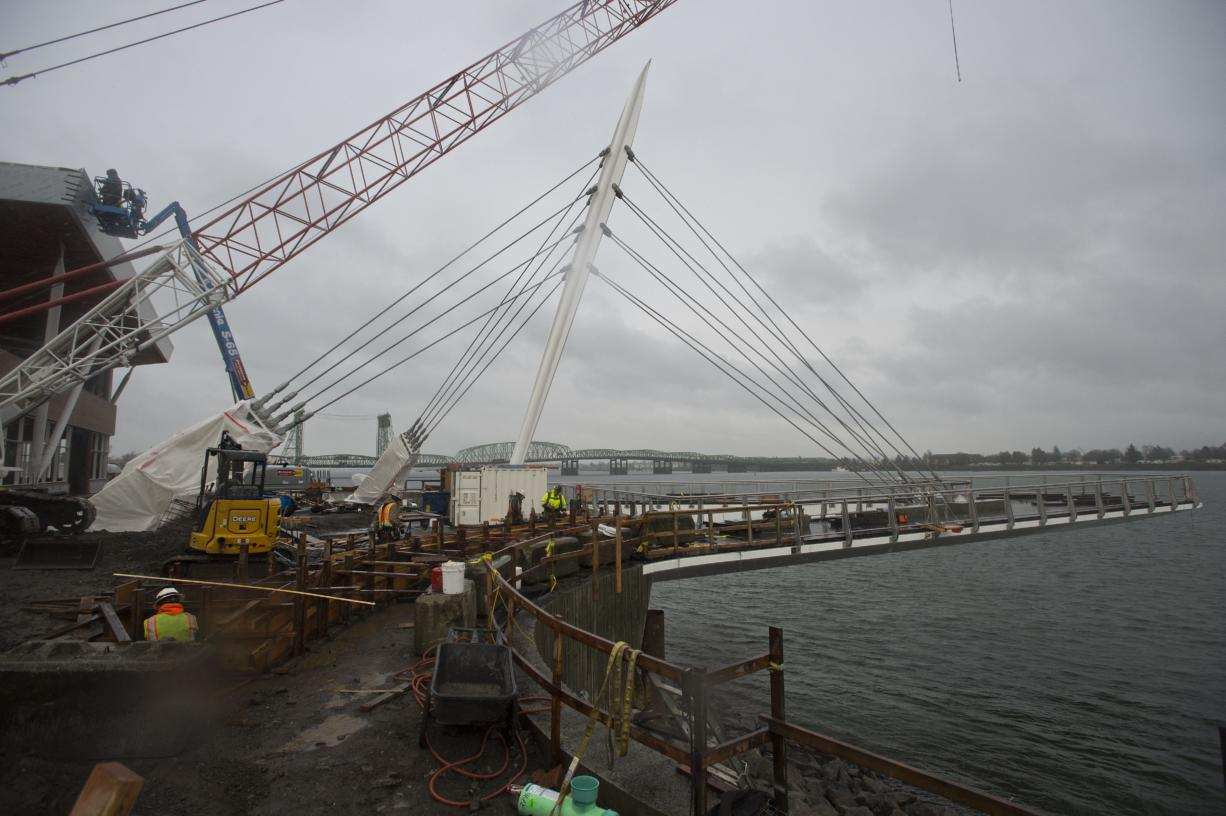 Construction continues at the Grant Street Pier, which recently had its pilings removed and is now floating over the Columbia River by its own cables, Thursday morning, Jan. 11, 2018. (Amanda Cowan/The Columbian)