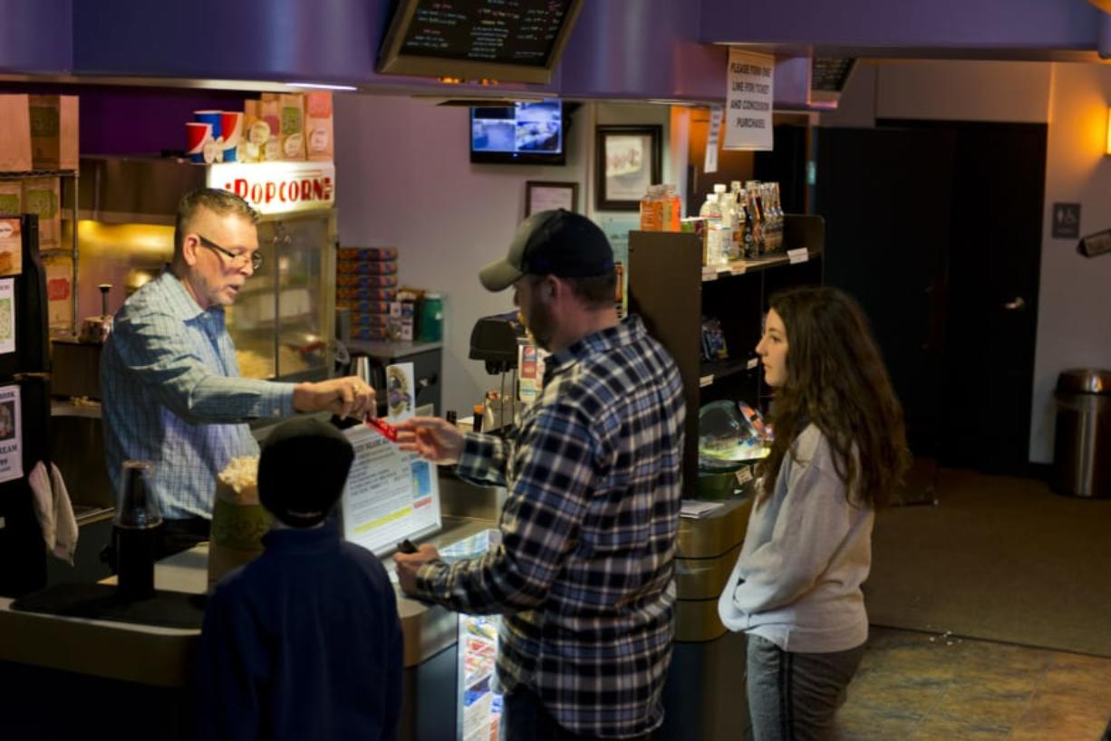 Attendance has ticked up slightly at The Liberty Theatre in Camas, said Managing Director Rand Thornsley, left, which he attributes to the growing popularity of MoviePass. Still, he wonders if the service can last.
