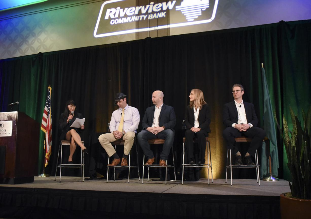 Moderator Mei Wu, from left, joins panelists Andy Lowery of RealWear, Kevin Getch of Webfor, Dorota Shortell of Simplexity Product Development and Aaron Holm of Blokable Inc. during the 2018 Economic Forecast Breakfast at the Hilton Hotel in downtown Vancouver, Thursday morning January 18, 2018.