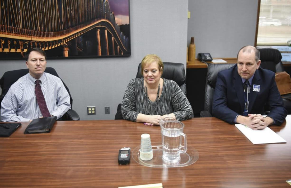 Evergreen Public Schools Chief Operating Officer Mike Merlino, left, school board director Victoria Bradford and Superintendent John Steach meet with The Columbian Editorial Board on Monday to discuss the district's $695 million bond request.