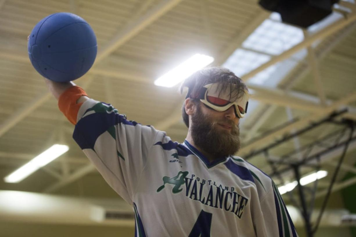 Natalie Behring/for The Columbian Goalball player John Hinman - who lives in Vancouver and plays for the Portland Avalanche - prepares to hurl a goalball during a practice session in the Kennedy Fitness Center at the Washington State School for the Blind. The Northwest Association for Blind Athletes hosted a skills clinic and scrimmage with the Tacoma Typhoon on Saturday afternoon.