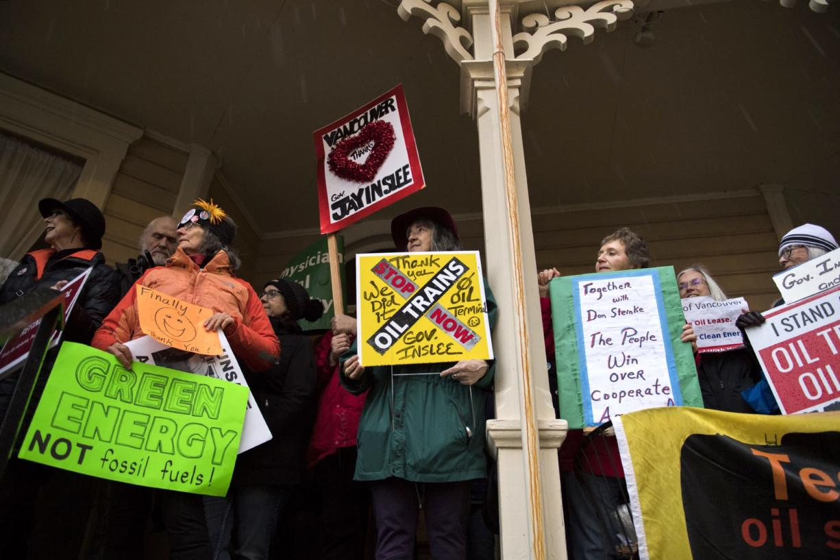 Opponents of the proposed Vancouver Energy oil-by-rail terminal celebrate the project's rejection Monday by Washington Gov. Jay Inslee at the Slocum House in downtown Vancouver on Jan. 29, 2018.  (Alisha Jucevic/The Columbian)
