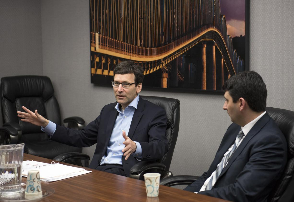 Washington Attorney General Bob Ferguson, left, and Washington Chief Deputy Attorney General Shane Esquibel, right, meet with the Columbian Editorial Board on Wednesday morning, Jan. 31, 2018.
