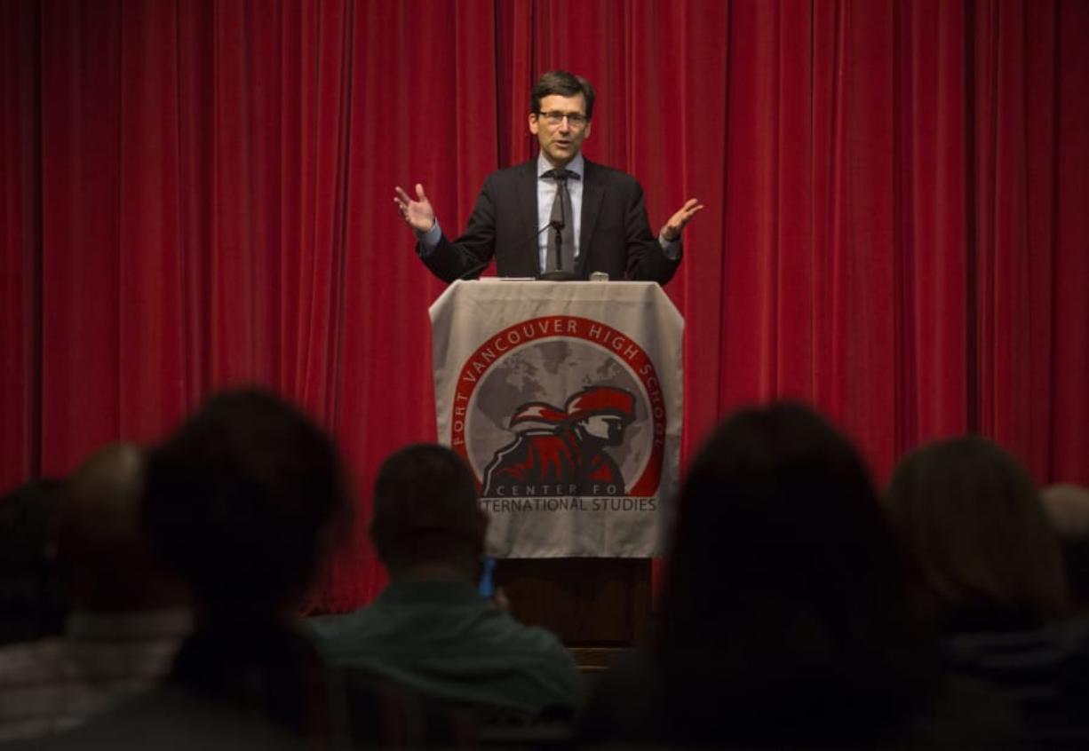 Washington Attorney General Bob Ferguson addresses a receptive crowd at Fort Vancouver High School on Tuesday night.