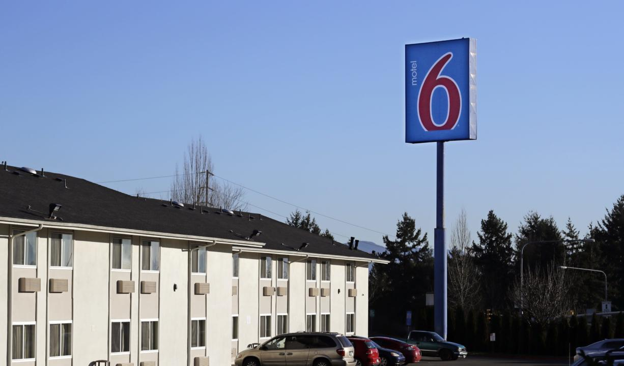 A Motel 6 motel is seen Wednesday, Jan. 3, 2018, in SeaTac, Wash. Washington's attorney general is suing Motel 6, saying the budget hotel disclosed the personal information of thousands of guests to federal immigration authorities in violation of state law. Attorney General Bob Ferguson said at a news conference Wednesday that the motel divulged to the U.S. Immigration and Customs Enforcement the names, dates of birth, license plate numbers and room numbers of more than 9,000 guests at six locations throughout the state.