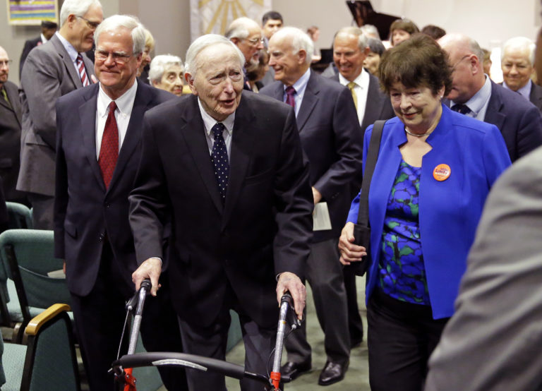 FILE - This Tuesday, May 30, 2017 file photo, former Washington Gov. John Spellman, second from left, leaves a memorial service in Renton, Wash. Spellman, the last Republican governor elected in Washington, has died at age 91. Spellman's son, Seattle attorney David Spellman, confirmed his death Tuesday, Jan. 16, 2018. (AP Photo/Ted S.