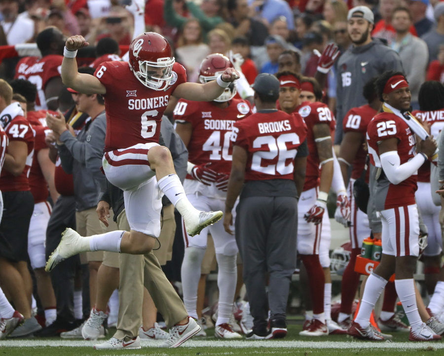fe7e7c6c1 Oklahoma quarterback Baker Mayfield (6) leaps and celebrates after he  scored a touchdown against