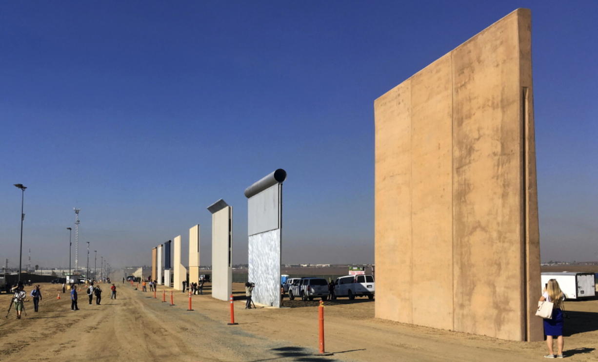 Prototypes of border walls are seen in San Diego on Oct. 26. A U.S. official says testing of prototypes of the proposed wall with Mexico found their heights should stop border crossers. Associated Press files