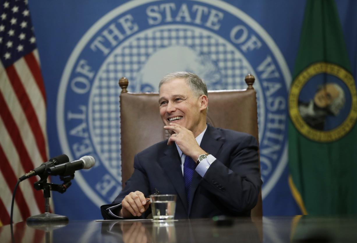 Washington Gov. Jay Inslee takes questions from reporters after he signed the capital budget Friday at the Capitol in Olympia. The signing came after the state Legislature approved more than $4 billion in construction projects across the state after reaching a deal on a contentious water issue that had stalled the capital budget for months. (AP Photo/Ted S.