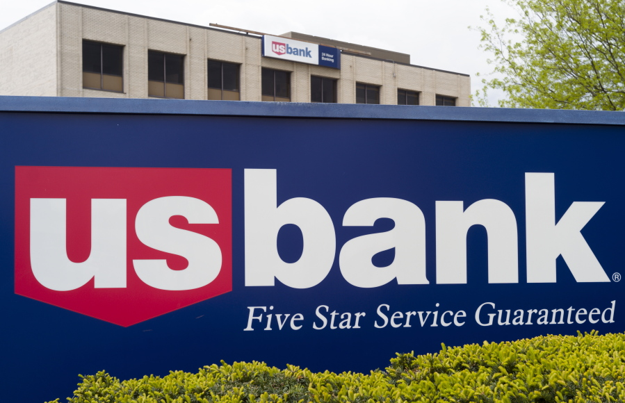 This Wednesday, May 3, 2017, photo shows a U.S. Bank branch in Omaha, Neb. Dozens of companies, including US Bancorp., have announced they are giving their employees bonuses, following the passage of the Republican tax plan that President Donald Trump signed into law in December.