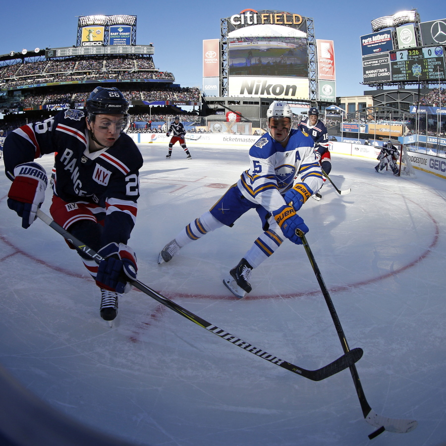 0bbda3c68 New York Rangers left wing Jimmy Vesey (26) battles for the puck with  Buffalo