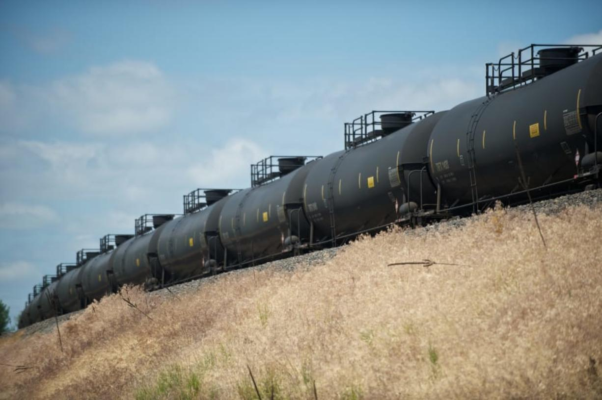 An oil train waits to move westbound in Vancouver.