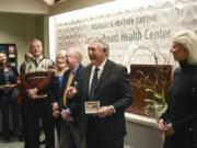Douglas Greene, center, and his wife, Heather Greene, right, donated $500,000 toward efforts to create a comprehensive cancer center at Legacy Salmon Creek Medical Center in Vancouver. The hospital named the breast center after the couple.