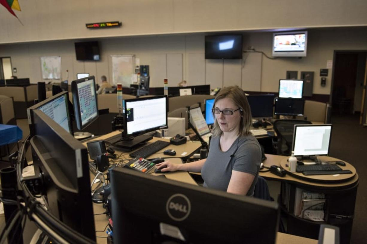 Dispatch supervisor Jodi Gaylord of Vancouver takes calls at Clark Regional Emergency Services Agency in downtown Vancouver. Gaylord said she listens for clues during calls that human trafficking may be taking place so she can alert officers responding to the scene.