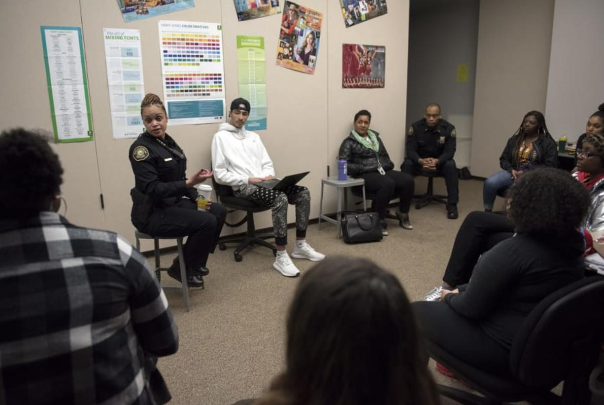 Portland Police Chief Danielle Outlaw talks with a group of Evergreen High School students during a Black Students United club meeting Thursday afternoon at the Vancouver school. The club launched this year in an effort to build unity at the predominantly white school.