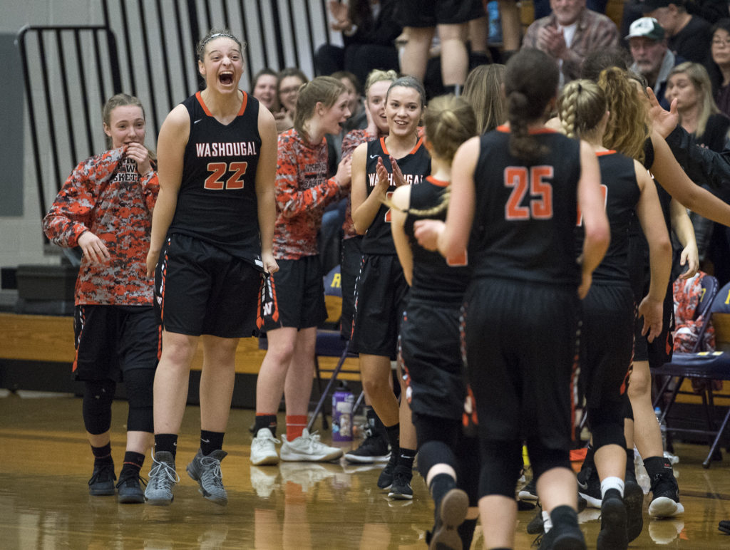 washougals emilee smart 22 cheers on her teammates as they come off the court for a timeout during thursday nights game at columbia river high school on