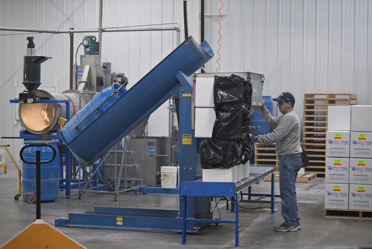 Production worker Rocky Schwab packages glue pellets while working at Northwest Adhesives at the Steigerwald Commerce Center in Washougal. The company is one of a handful that own land at the business park, which is part of the Port of Camas-Washougal.