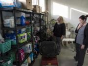 A Caring Closet co-founders Jodie Zelazny, left, and Sara Scheetz look over the variety of medical equipment they have available for those who need it. The nonprofit's most requested items are wheelchairs, walkers, bath benches, adult briefs and scooters.