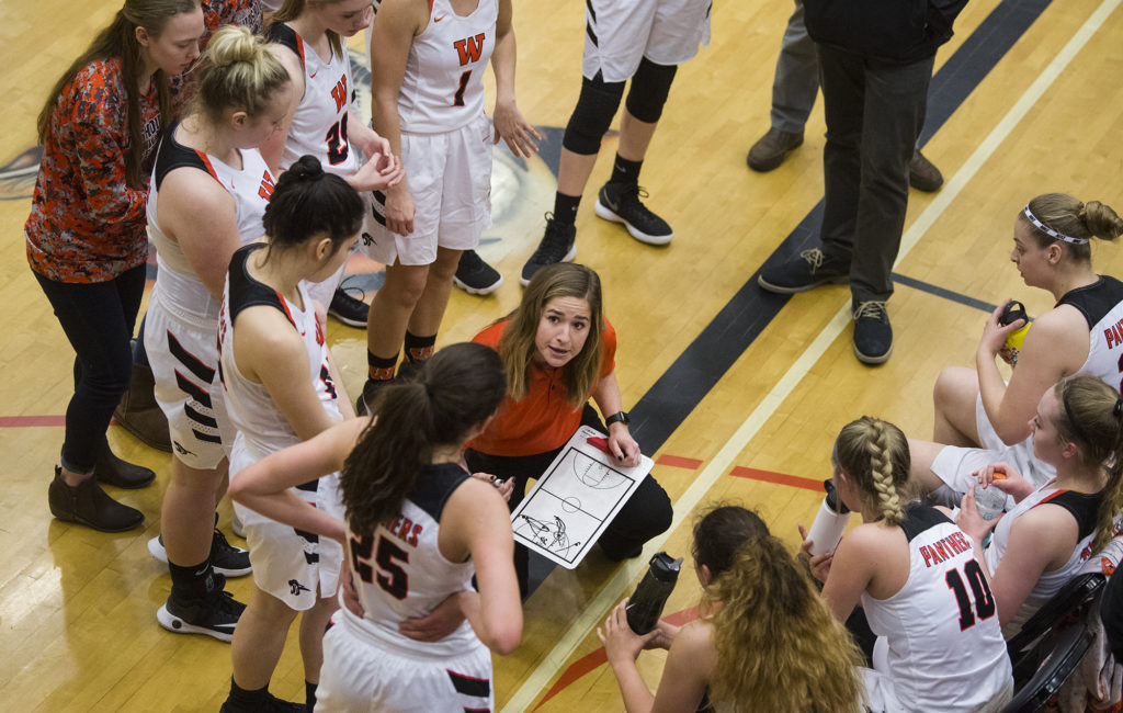 center goes over a play with washougals girls basketball team during a timeout in the 2a regional game against fife at battle ground high school
