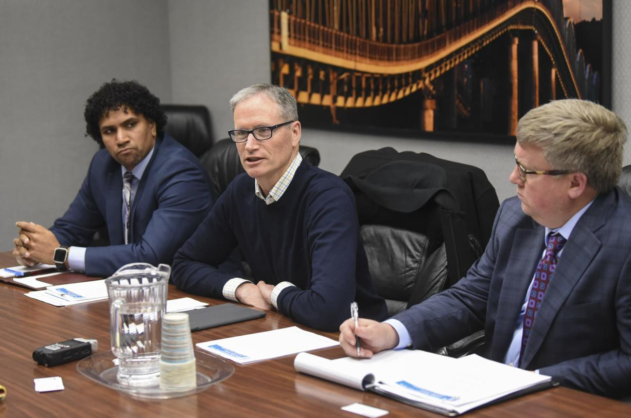 Oregon Department of Transportation Commissioner Alando Simpson, from left, Commissioner Sean O'Hollaren and Region 1 Manager Rian Windsheimer discuss the state's plan for tolling Interstate 5 and Interstate 205 with The Columbian Editorial Board on Wednesday.