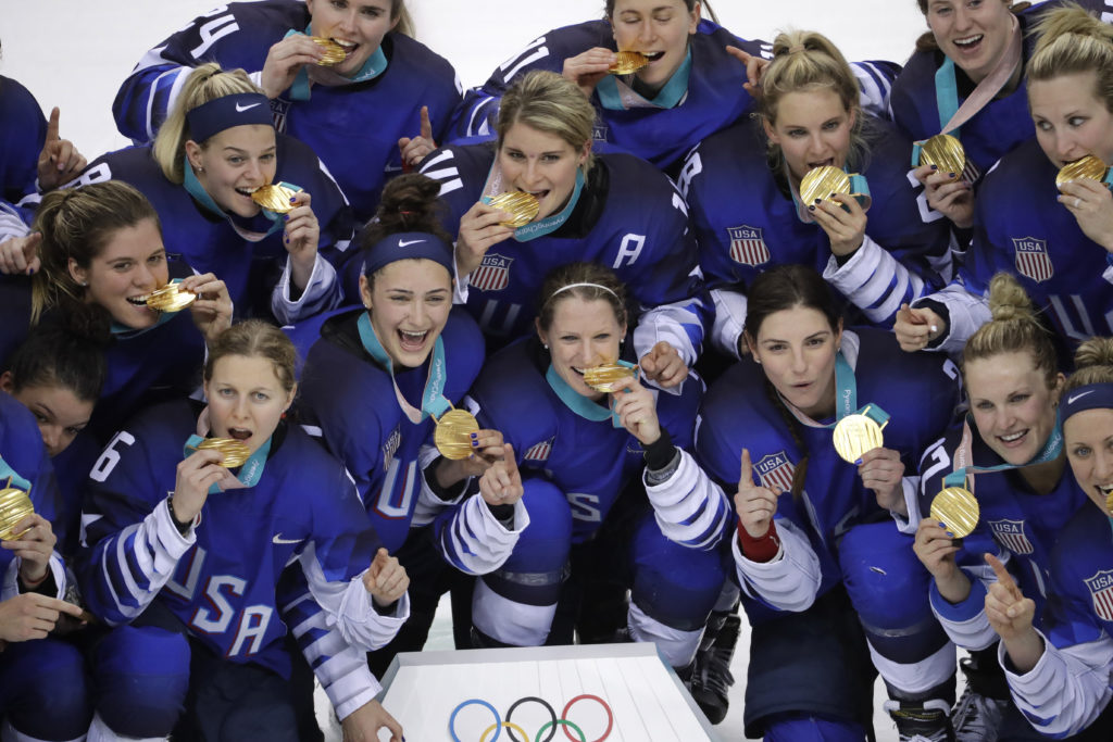 ede00aa4cbe Untied States hockey team celebrate with their gold medals after beating  Canada in the women s