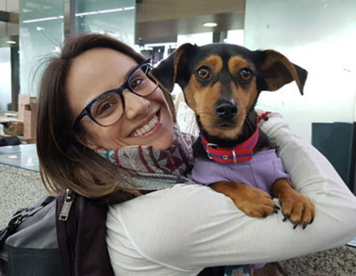 In this undated photo provided by Free Korean Dogs, Canadian figure skater Meagan Duhamel poses with her dog Moo-tae, right, in South Korea. Duhamel already has one life-changing souvenir from South Korea, and it's not a medal. The Olympic pairs skater rescued a puppy from the Korean dog meat trade while competing in Pyeongchang last year, and she's helping organize more adoptions while skating there at this year's games.