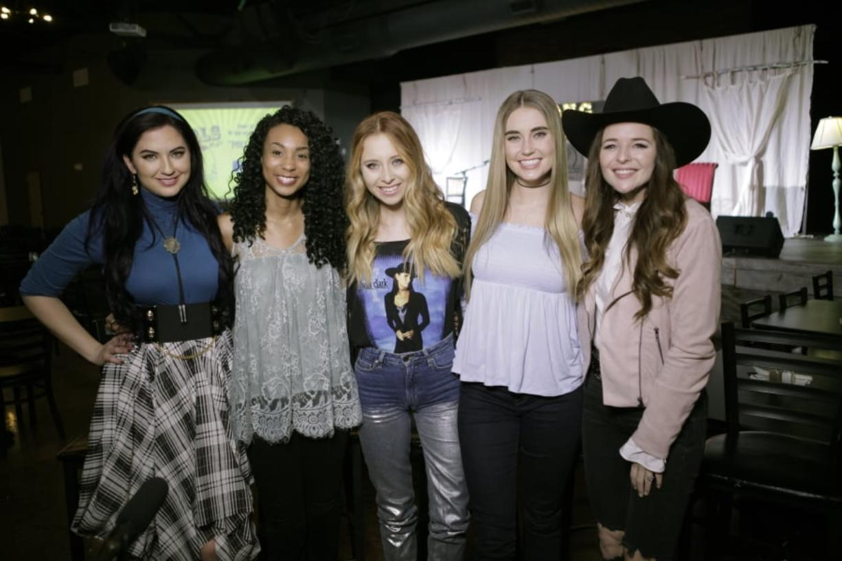 """Song Suffragettes, Inc., members of the Song Suffragettes, from left, Candi Carpenter, Tiera Leftwich, Kalie Shorr, Chloe Gilligan and Jenna Paulette are seen Jan. 29 in Nashville, Tenn. Female musicians in Nashville have complained about the lack of representation on country radio. Now, female songwriters are singing """"Time's Up."""" Quinton Cook/Song Suffragettes, Inc."""