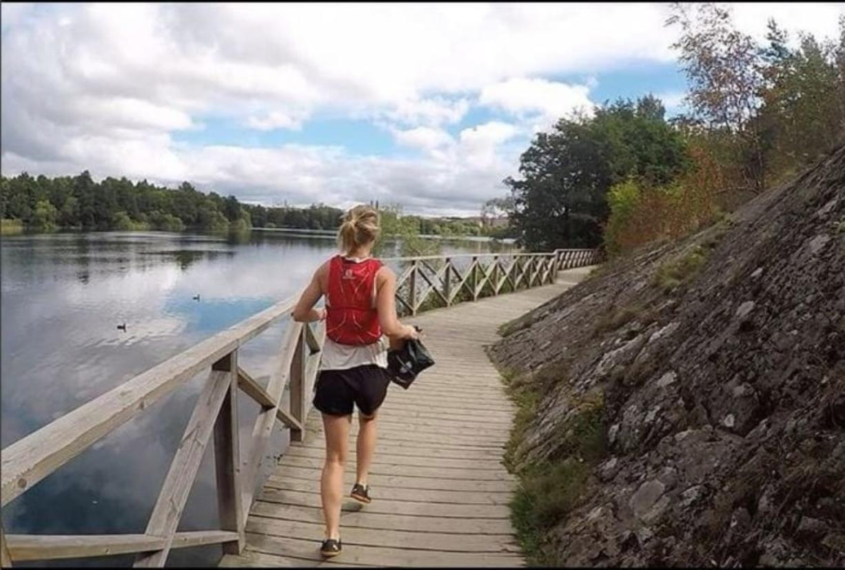 Maja Tesch carries a bag containing litter while plogging in Stockholm.