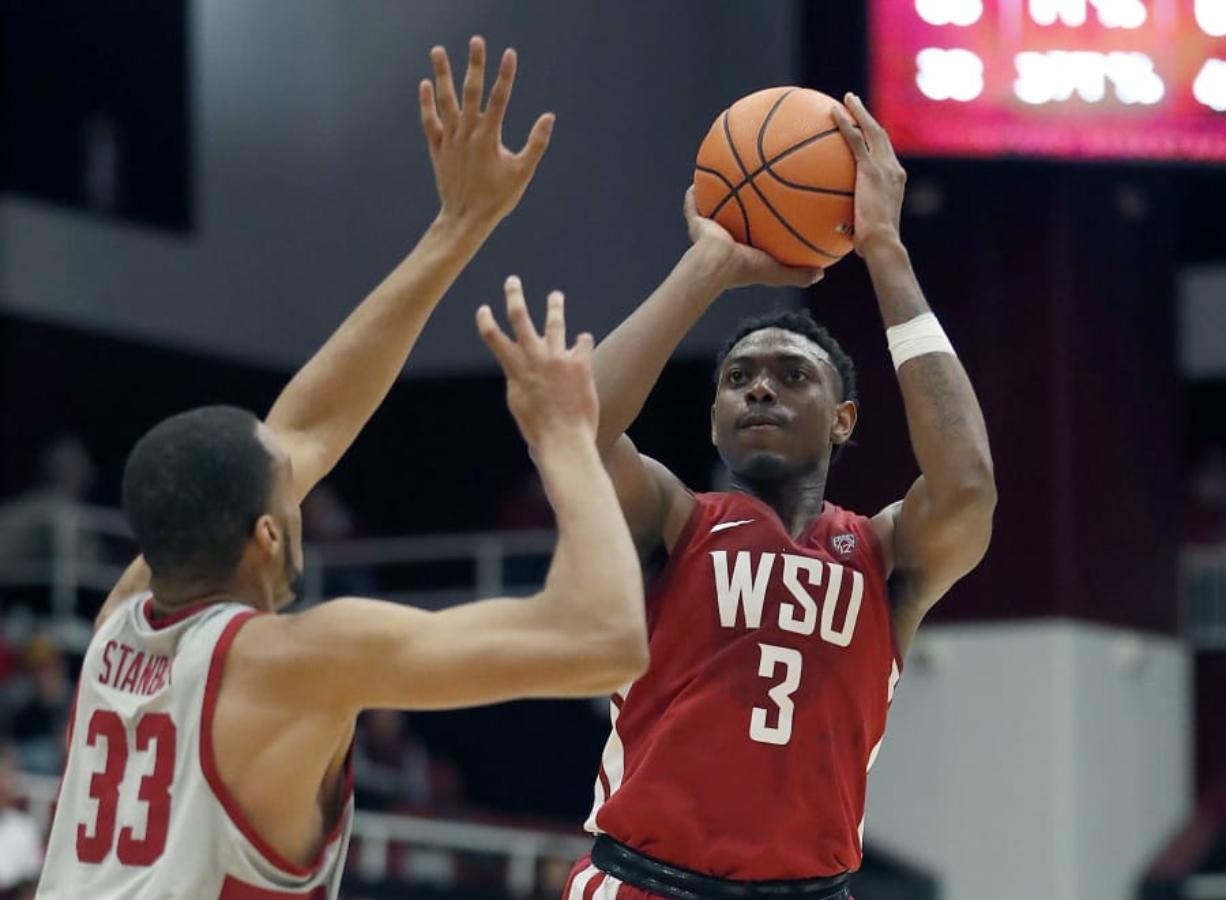 Washington State forward Robert Franks (3) takes a shot over Stanford forward Trevor Stanback (33) during the second half of an NCAA college basketball game Saturday, Feb. 24, 2018, in Stanford, Calif. Stanford won 86-84. (AP Photo/Tony Avelar)