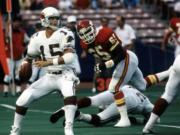 After starring at Portland State, Neil Lomax played nine NFL seasons with the St. Louis Cardinals.