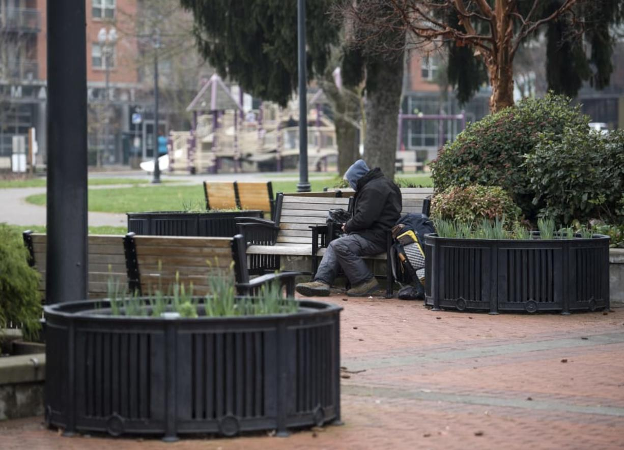 A homeless man, who prefers not to be named, sits on a bench Feb. 8 at Esther Short Park in downtown Vancouver.