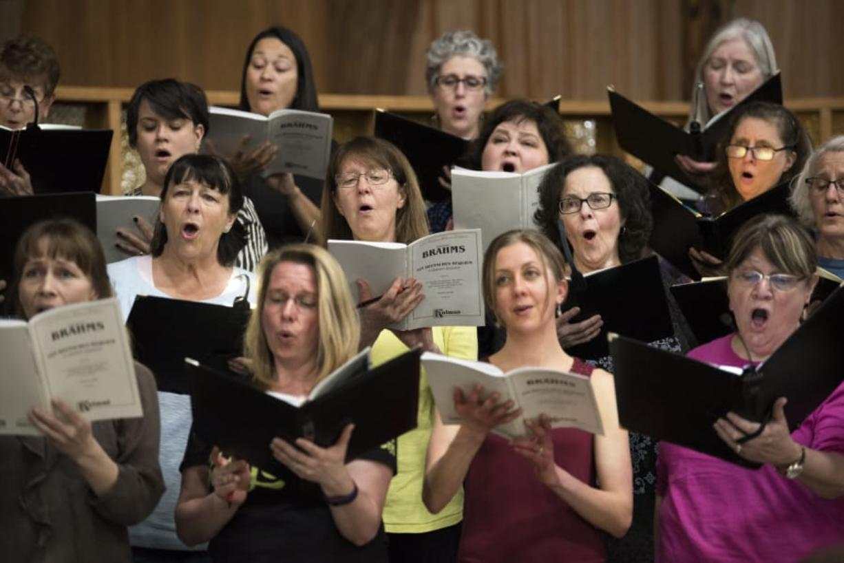 "The Vancouver USA Singers rehearse for their upcoming performance of Brahms' ""German Requiem"" on Monday evening at First Presbyterian Church in Vancouver. Nearly 100 singers and a small orchestra will perform in this weekend's show."