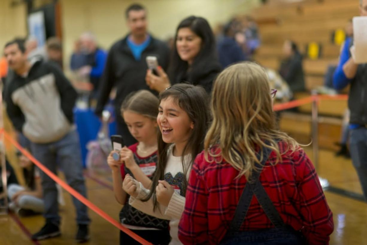 Bella Torres, 9, of Pioneer Elementary School, beams after a solar car she built with her team won her race.
