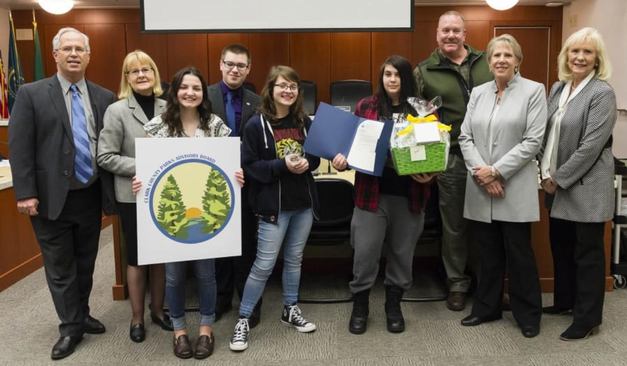 Orchards: The Clark County Council honored four Heritage High School students for work in a contest to design a new logo for the Clark County Parks Advisory Board. From left: Council Chair Marc Boldt, Councilor Jeanne Stewart, first-place winner Heidi Hayden, second-place winner Eli Entwistle, third-place co-winner Jennifer Jones, third-place co-winner Viktoria Kryshtal, Bill Bjerke, parks manager, Councilor Julie Olson and Councilor Eileen Quiring.