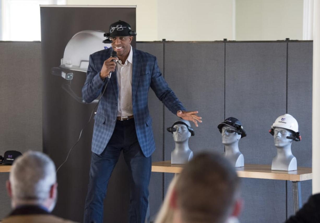 Retired professional basketball player Jerome Williams speaks during the GROW Clark County networking event, which featured hardware company RealWear. Williams joined the company's advisory board in February and hopes to use its head-mounted computer to coach basketball. Alisha Jucevic/The Columbian