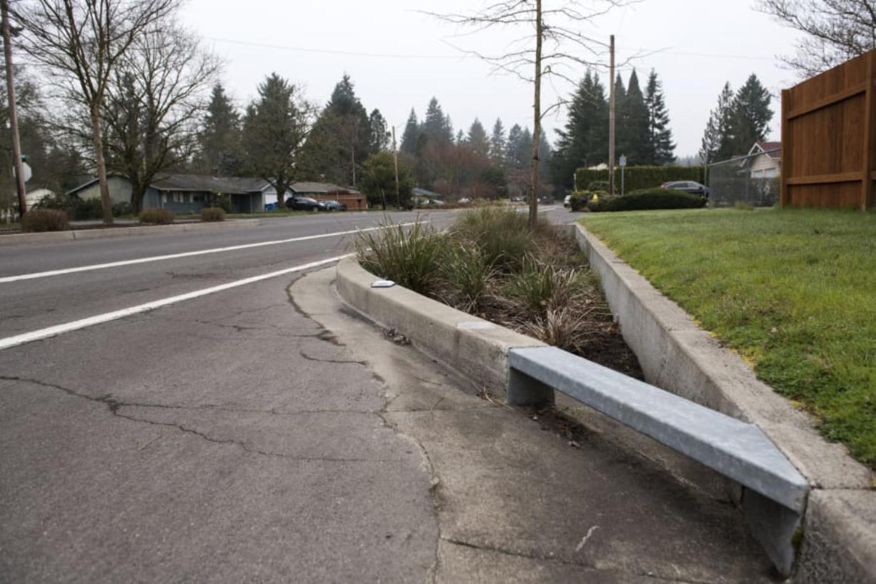 A rain garden, also known as a bioretention facility, is pictured along Northeast 98th Avenue in Vancouver's Oakbrook Neighborhood. Rain gardens improve stormwater quality by filtering out some pollutants that would otherwise end up in streams and other waterways. The state Department of Ecology recently offered $220 million in funding to build clean water facilities around the state.