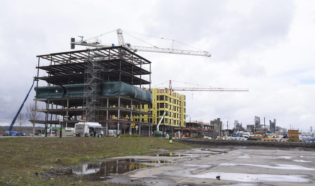 A seven-story office tower, left, is pictured next to a future apartment building, Monday March 5, 2018, at the Vancouver waterfront.