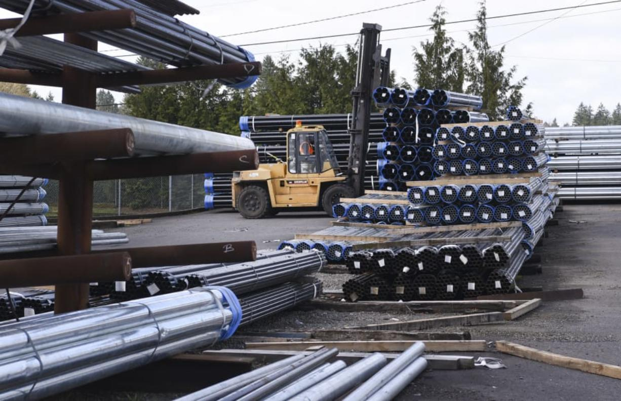 Jorge Sanchez, yard supervisor at State Pipe & Supply in Vancouver, moves bundles of steel pipe with a forklift Wednesday. Tariffs and new trade agreements could affect the supply of steel in Clark County, industry experts say.