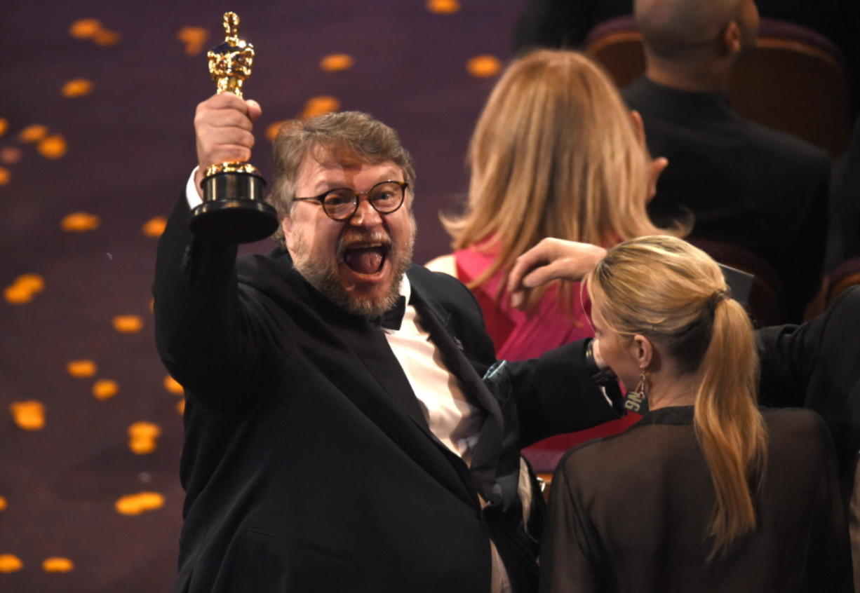 """Guillermo del Toro, winner of the award for best director for """"The Shape of Water"""" celebrates in the audience at the Oscars on Sunday at the Dolby Theatre in Los Angeles."""
