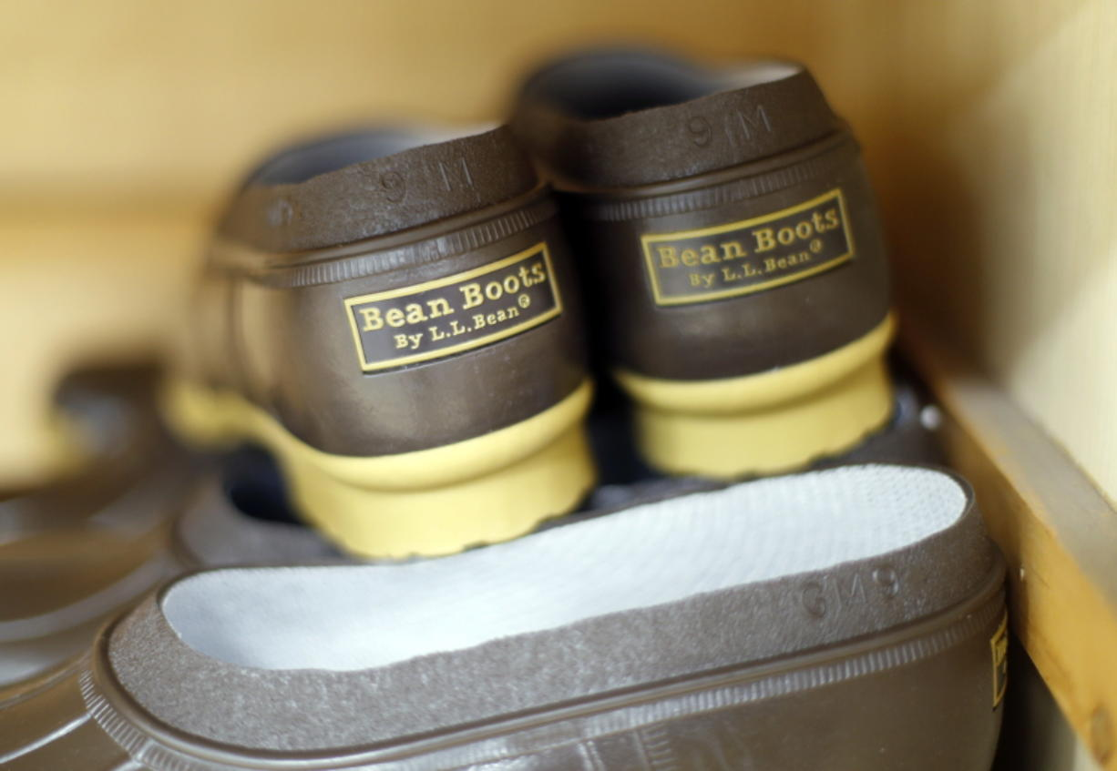 FILE - This Aug. 17, 2017 file photo shows a pair of boots at the L.L. Bean manufacturing center in Lewiston, Maine. On Friday, March 16, 2018, the company announced its sales dipped slightly over the past year, forcing the elimination of worker bonuses for the first time since 2008, but the CEO told workers that changes adopted in recent months are putting the company on a 'Äúpath to a more prosperous future.'Äù (AP Photo/Robert F. Bukaty, File)