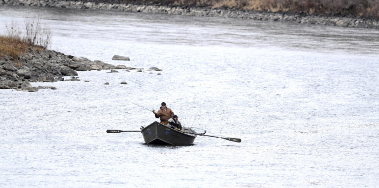 Fishermen have the Clearwater River to themselves on Feb. 4, 2014, in Lewiston, Idaho. Fisheries managers should shut down steelhead fishing in the Columbia and Snake river basins to protect a wild run that returns to Idaho's Clearwater River, according to a conservation group.