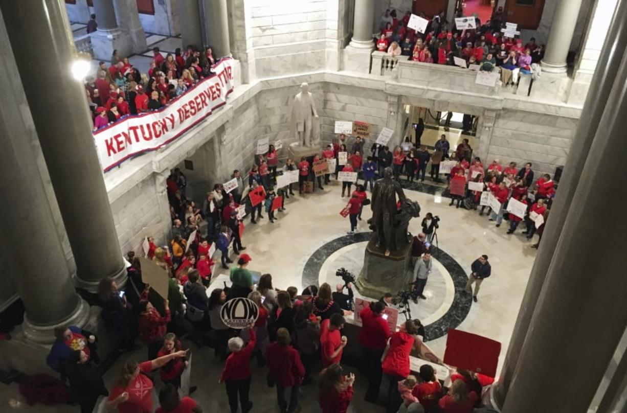 Hundreds of Kentucky teachers protest outside of Gov. Matt Bevin's office on Friday, March 30, 2018, in Frankfort, Ky. State lawmakers passed a bill late Thursday night that makes changes to the state's pension system. Bevin could sign the bill into law on Friday.
